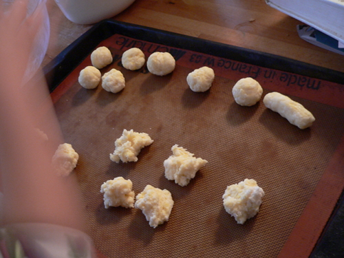 the kids making pao de queijo balls